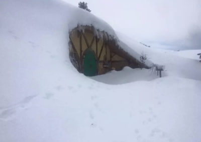 Exterior Snow-Covered Underground Tiny Home